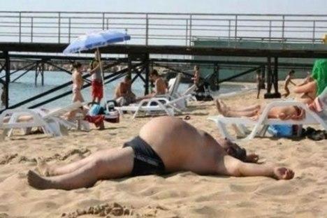 Fat-Guy-In-A-Little-Beach