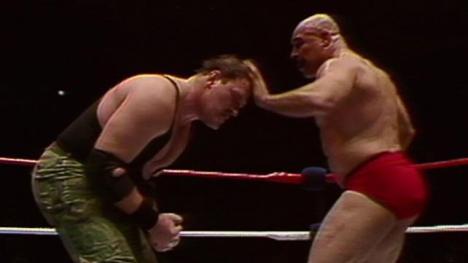 Hulk Hogan and Iron Sheik going at it.